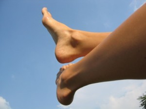 Two feet against a sky